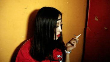 Chinese girl smoking cigarette.