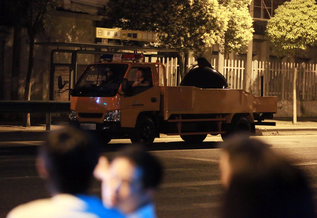 Chinese bomb disposal vehicle on the scene where a 62-year-old Chinese man in Baoshan district of Shanghai went on a killing spree with his hunting rifle.