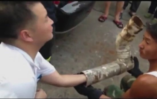 Firefighters and rescue personnel removed the section of drain pipe where a Chinese newborn baby was found still alive after his mother gave birth to him while on the toilet.