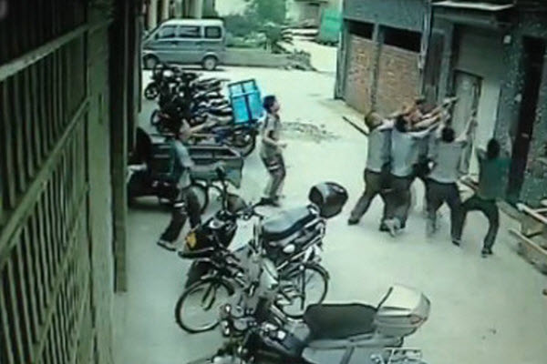 A group of Chinese delivery men collectively catch a little toddler girl after she fell from her 4th floor home.