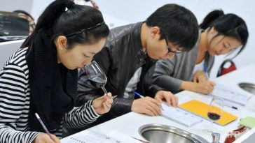 Chinese students learning about wine.