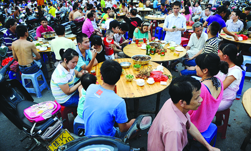 Local residents are gathering at a riverside road in Yulin to eat dog meat on June 21.