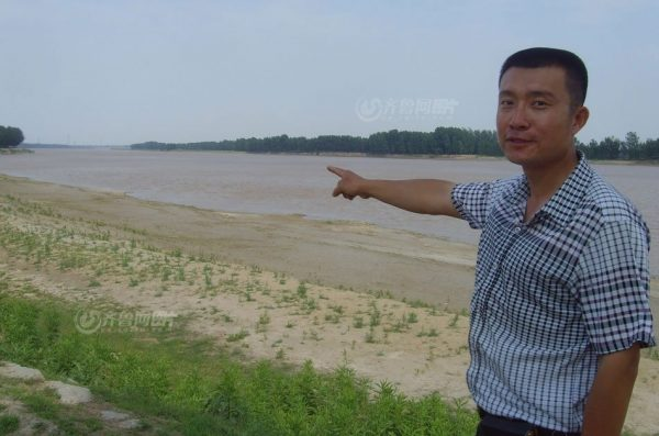 "Li Kai was pointing at the shore where he had captured the ""alien""."
