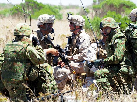 Members of American marines and Japanese Ground Self Defense Force in Japan-US joint military exercises.