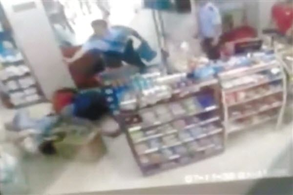 Anhui, China - Surveillance footage shows two Chinese police officers failing to stop a man from murdering a young girl.