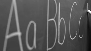 Aa Bb Cc written in chalk on blackboard.
