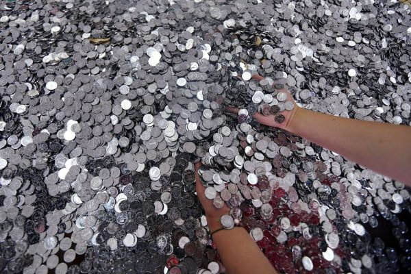An ICBC bank in Kunming had 18 employees spend all day counting 10,000 RMB in 1 jiao (10 cent) coins.