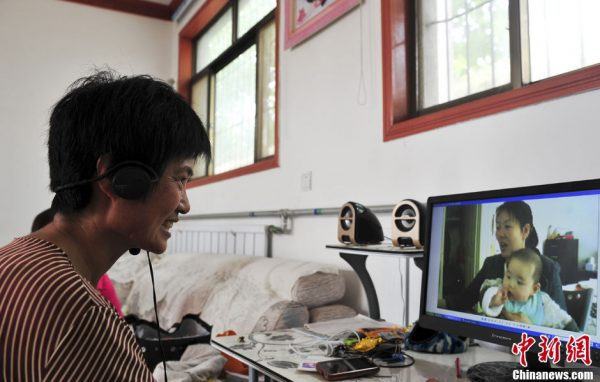 A villager is having a video chat with her family in Australia.