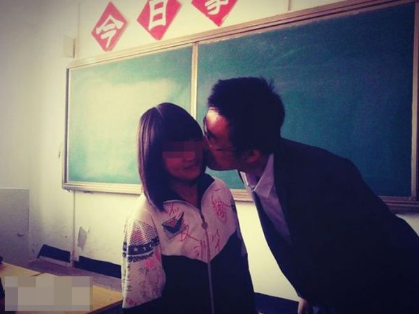 Teacher Zhang is kissing a female students.