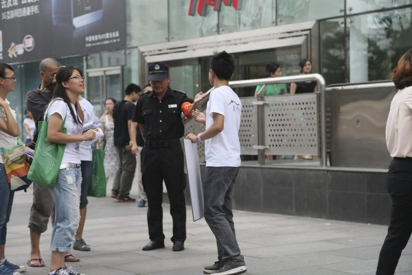 The AIDS-infected man is getting shooed by a mall cop while seeking marriage on the street.
