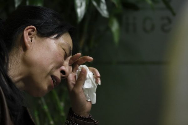 Xia Junfeng's wife, Zhang Jing, crying.