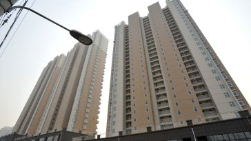 A new high-rise residentail apartment building in Qingdao, China with fake windows that were painted onto the walls.