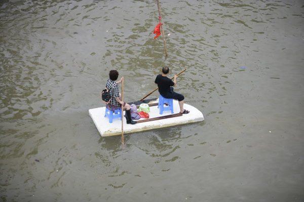 Yuyao Chinese residents on a make-shift boat .