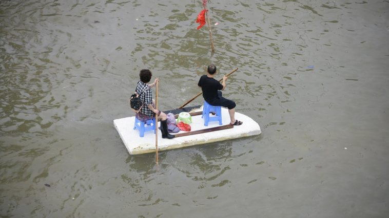 Yuyao Chinese residents on a make-shift boat .