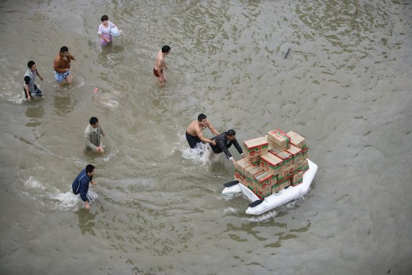 Scene of looting of supplies in Yuyao, Zhejiang, the site of severe flooding caused by Typhoon Fitow.