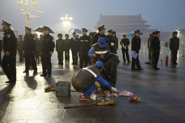Garbage and litter left in Tiananmen Square after crowds watched the National Day flag-raising ceremony.