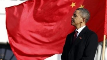Obama under the flag of China.