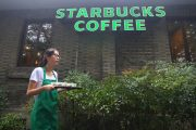 A Chinese Starbucks employee hands out free samples.
