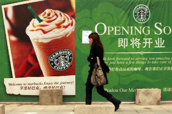 Temporary storefront advertising the opening of a Starbucks in China.