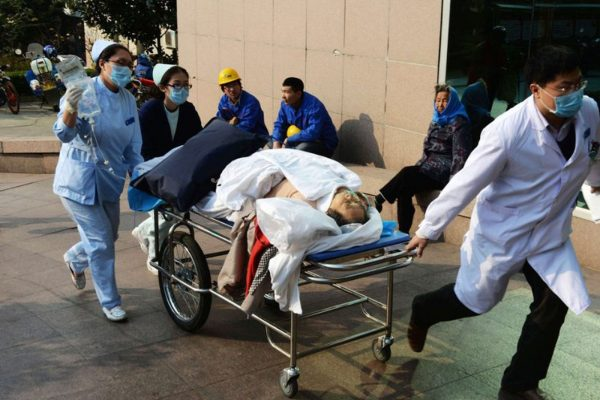 Photo of medical workers carrying injured persons.