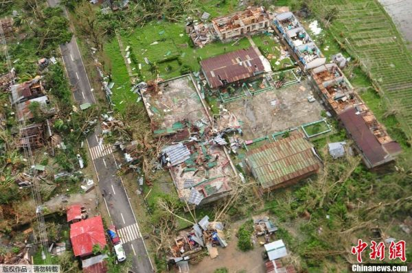 The damaged houses in Iloilo of the Philippines after the attack of the typhoon.