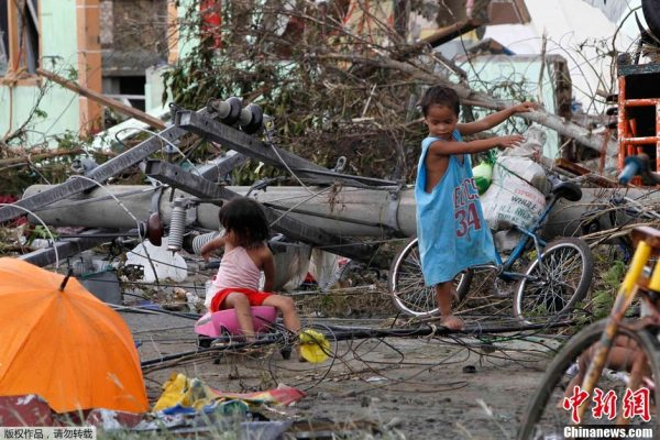 Children are playing in the ruins after the typhoon attack.