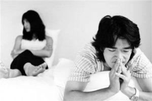 Unhappy Asian couple.