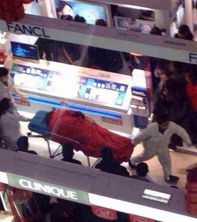 A Chinese man leaped to his death at a shopping mall in Xuzhou, China apparently fed up with his girlfriend's shopping spree.