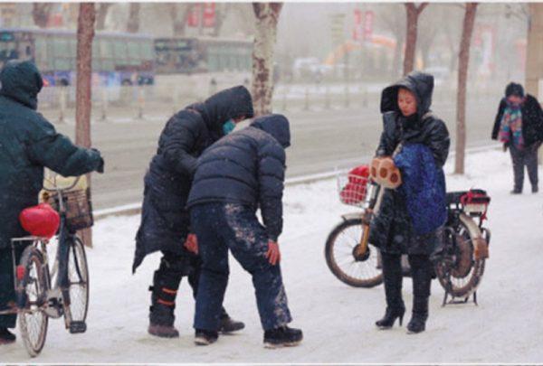 The elderly man examining his leg.