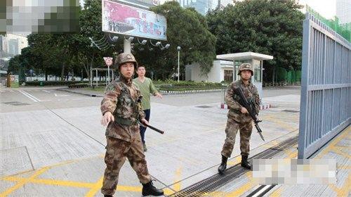 Hong Kong demonstrators trespassed into PLA headquarters carrying British Colonial Hong Kong flags.