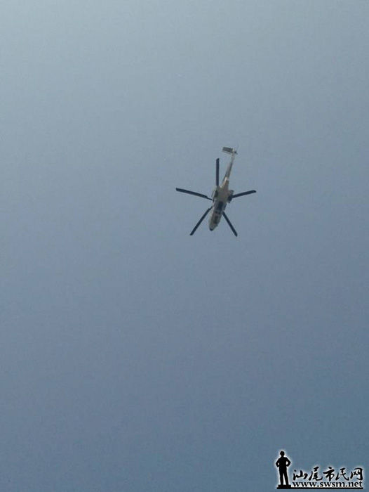 An airborne helicopter is on the guard.