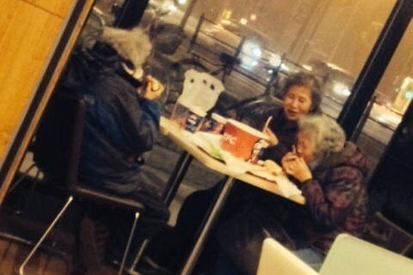 Three Chinese elderly women dining on a Family Bucket at Kentucky Fried Chicken on Chinese New Year's Eve, breaking the hearts of Chinese netizens.