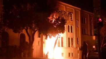 The scene of the fire burning at the front door of Chinese Consulate.