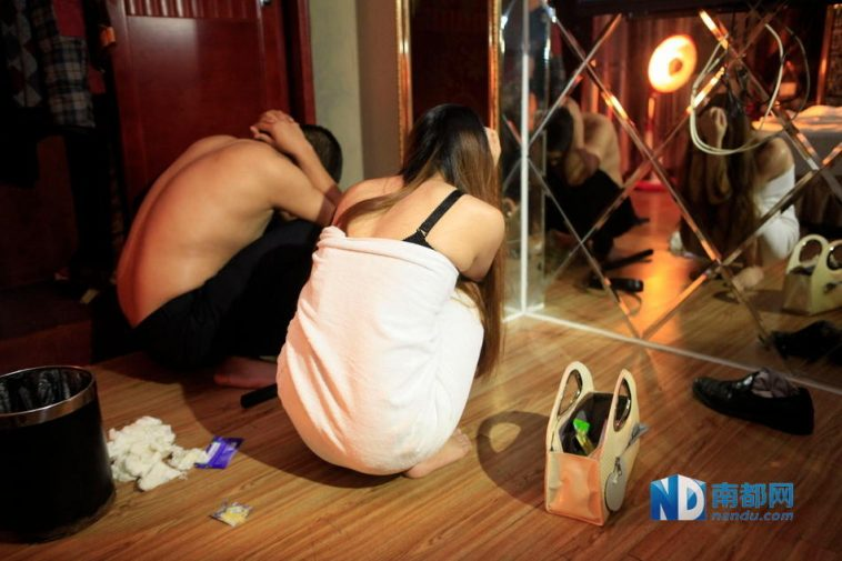 A prostitute and john arrested in Dongguan.