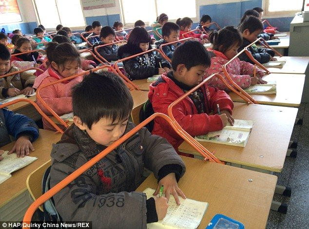 Bars/railings installed on school desks at a primary school in Wuhan, China help students develop good habits and discourage the development of myopia near-sightedness.