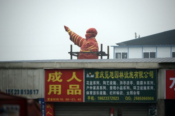 The Mao Zedong statue wrapped in red cloth.
