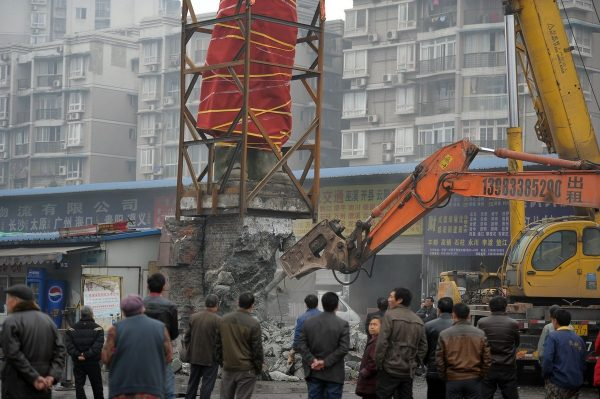 The Mao Zedong statue's pedestal being demolished.