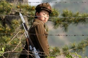 North Korean female soldier guarding a prison/concentration camp.