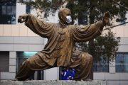 Statues in Peking University wear masks for heavy smog