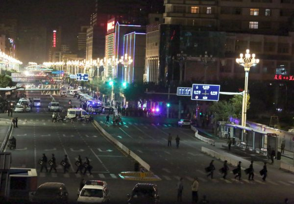 One of the roads to Kunming Train Station is blocked.