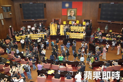 Hundreds of students breached and occupied the Legislative Yuan assembly hall.