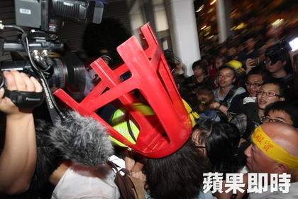 Security at the Legislative Yuan were overwhelmed, the assembly hall breached by the students.