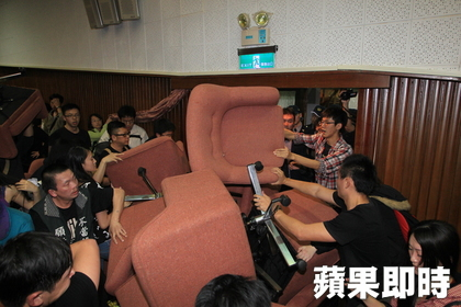 Students use chairs from the assembly hall to block off the entrance.