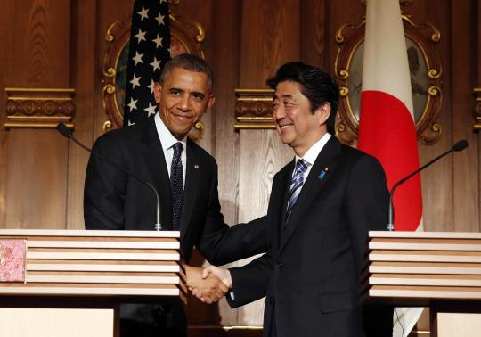 Obama shaking hands with Japan's Prime Minister Shinzo Abe.