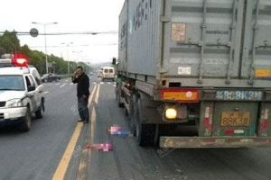 A mother in China threw her baby daughter under the wheels of a passing truck after a fight with her husband in which both said they didn't want custody of the children.