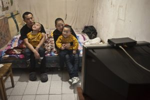Chinese parents of twin boys with cerebral palsy.