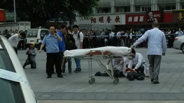 Medical personnel attending to one of the people wounded in a knife attack at Guangzhou Railway Station.