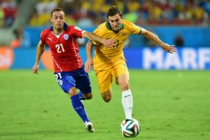 Chile's midfielder Marcelo Diaz (L) vies with Australia's forward Tommy Oar during a Group B football match between Chile and Australia at the Pantanal Arena in Cuiaba during the 2014 FIFA World Cup on June 13, 2014. AFP PHOTO / MARTIN BERNETTIMARTIN BERNETTI/AFP/Getty Images