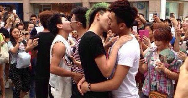 Chinese homosexual men participating in a gay kissing competition in Chengdu, China.