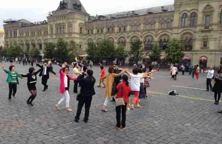 """Chinese """"aunties"""" (older middle-aged women) """"plaza dancing"""" at Moscow's Red Quare."""